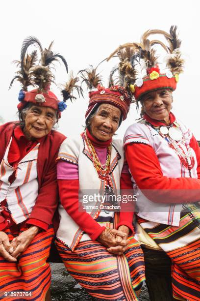 Three Ifugao (ancient culture of wet-rice agriculturalists) women in traditional dress and hats, Banaue, Luzon Island, Philippines (Model Releases, all three)