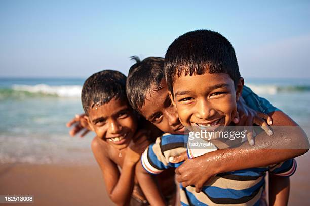 Three Indian boys on the beach