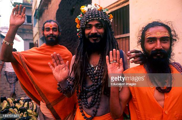 Three Indian Sadhu Priests Giving Blessing With Smile Near The Holy River Ganges In The Oldest City Of India Banaras Now Varanasi Uttar Pradesh India