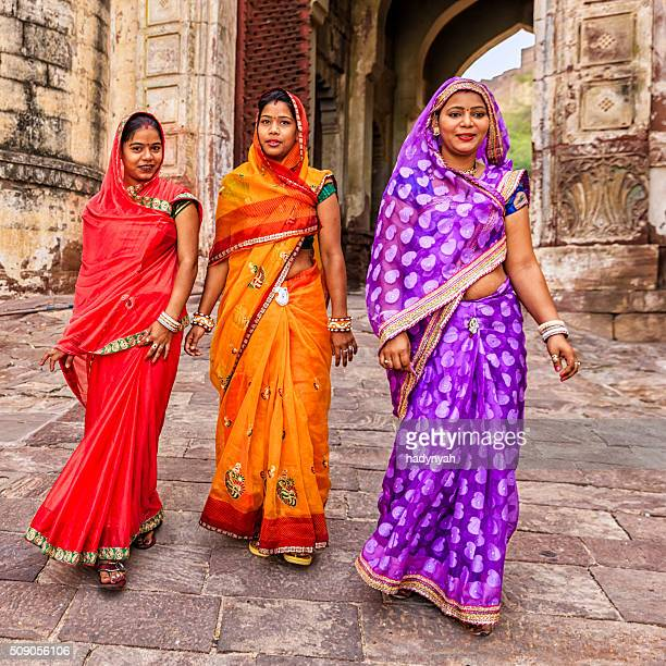 three indian women on the way to mehrangarh fort, india - sari stock pictures, royalty-free photos & images
