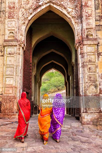 three indian women on the way to mehrangarh fort, india - jodhpur stock pictures, royalty-free photos & images