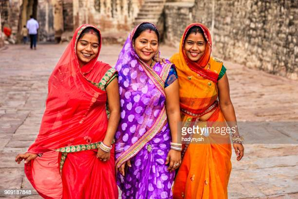 three indian women on the way to mehrangarh fort, india - traditional clothing stock photos and pictures