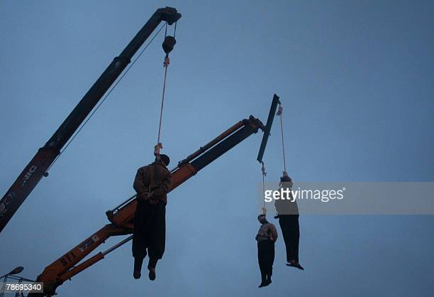 Three Iranian drug traffickers hang limply from the nooses as it snows in a square in the central city of Qom 120 kms south of the capital Tehran 02...
