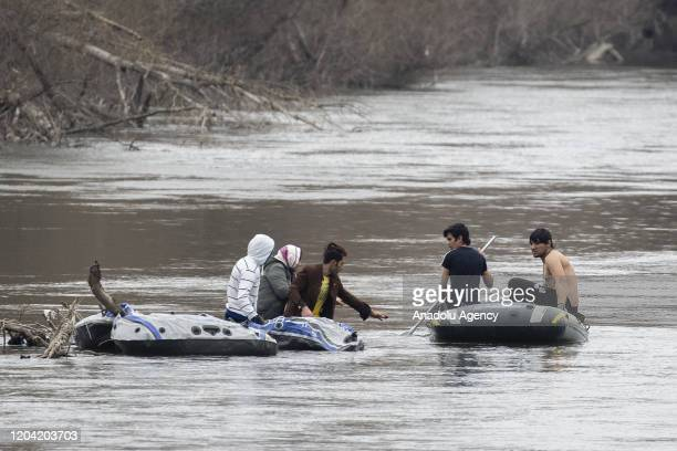 Three irregular migrants stranded in middle of Evros River as they return to Turkish side after Greek soldiers' warning shots are being rescued by...