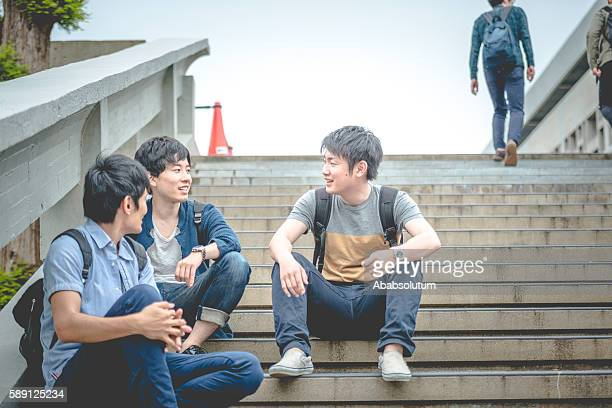 Three Japanese Students Discussing on Staircase, Campus, Kyoto, Japan, Asia