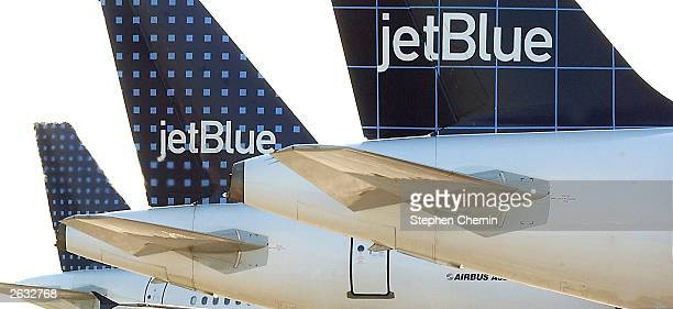 Three Jet Blue Airways planes are shown on the tarmac at Kennedy International Airport February 6 2003 in New York City Jet Blue announced October 23...