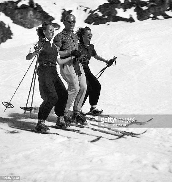 Three joyful skiers, 1946 in Tyrol, Austria.