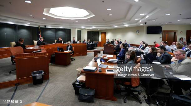 Three judge panel listens during the first day of the gerrymandering trial challenging the North Carolina legislature district lines Monday, July 15,...