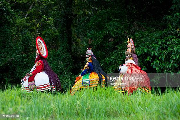 three kathakali dancers walking together, southern india - hugh sitton india stock pictures, royalty-free photos & images