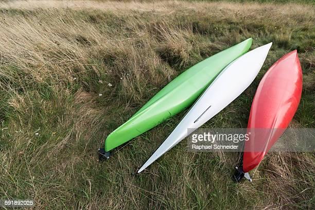 Three kayaks laid out like the Italian flag
