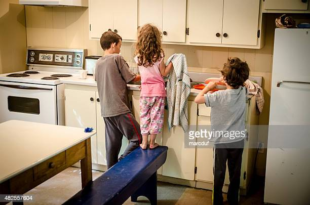 Three kids doing the dishes