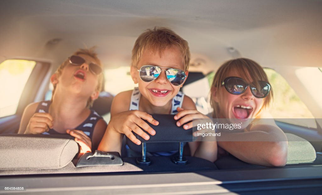 Three kids having fun on road trip : Stock Photo