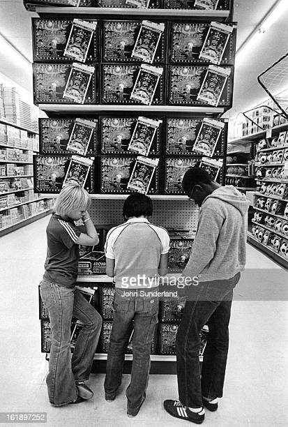 DEC 3 1980 DEC 19 1980 Three Kids of our time Engrossed in new game Atomic arcade pinball is one of electric games at Lionel Playworld