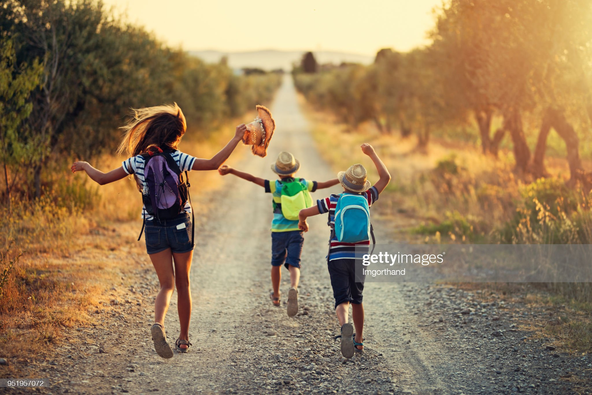 Three kids running on last day of school : Stock Photo