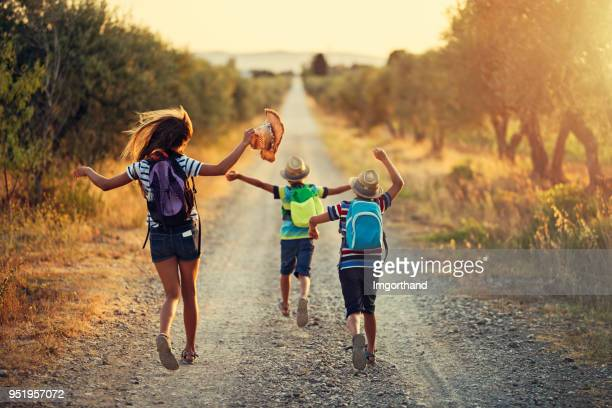three kids running on last day of school - finishing stock pictures, royalty-free photos & images