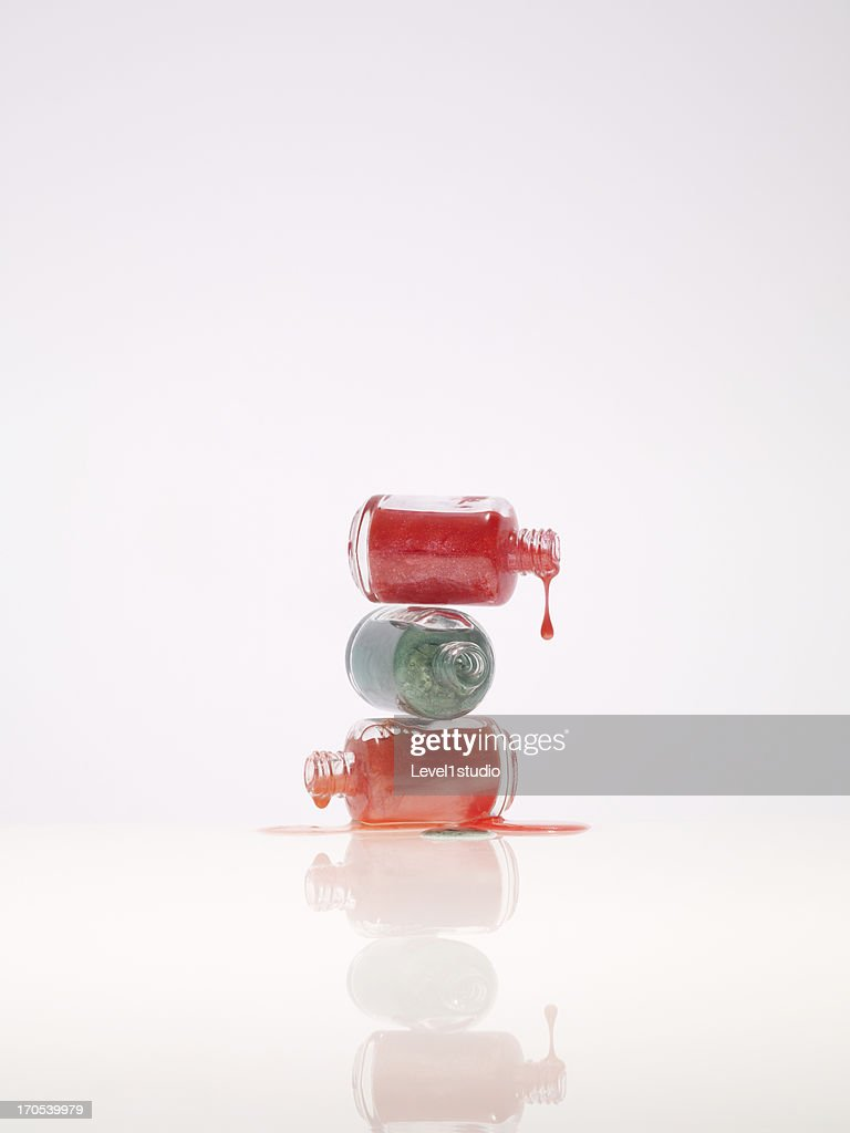 Three kind of nail polish dripping from bottle : Stock Photo