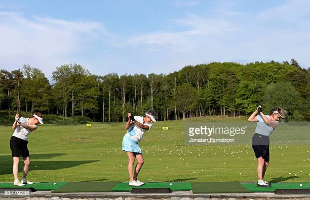 three ladies at driving range - driving range stock pictures, royalty-free photos & images