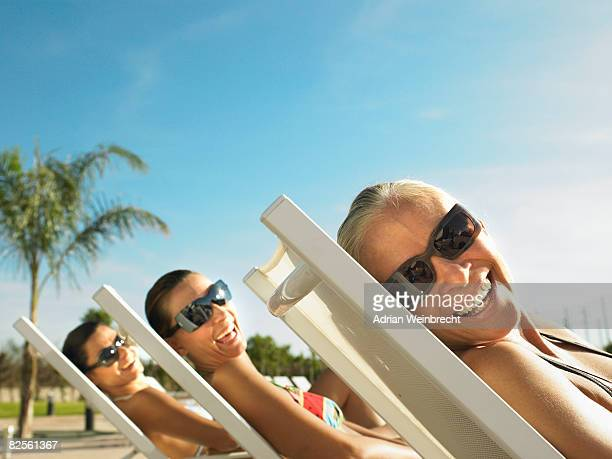 three ladies relaxing in the sun - hot spanish women stock pictures, royalty-free photos & images