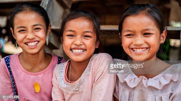 Three Laotian little girls in a village in Northern Laos