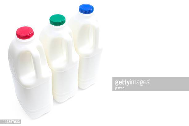 three large bottles of milk on a white with path - milk pack stock photos and pictures