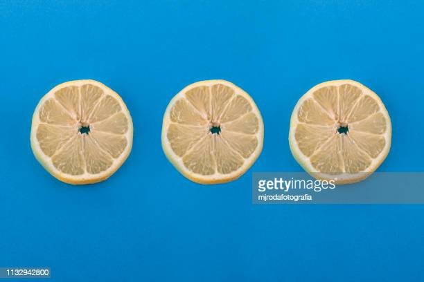 three lemon slices. - fruta stock photos and pictures