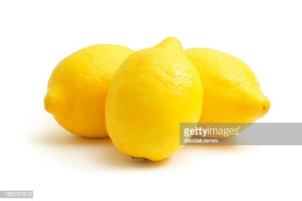 three lemons - lemon stock pictures, royalty-free photos & images