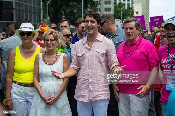 Three levels of Canadian Government partake for the first time in Pride Parade Kathleen Wynne Justin Trudeau and John Tory