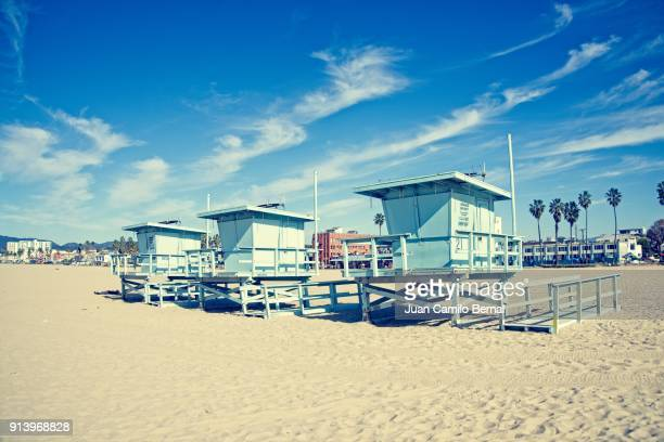Three lifeguard towers on the beach at Venice Beach, California