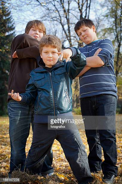 three little gangster boys posing in autumn park - chubby boy stock photos and pictures