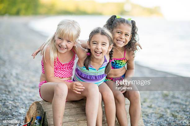 Three Little Girls are Laughing at the Beach