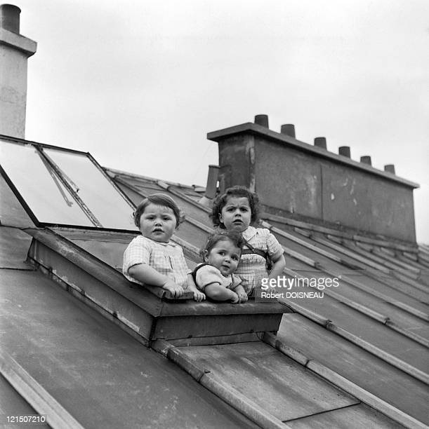 Three Little Girls Gazing At The Roofs Of Paris Through A Fanlight In 1957