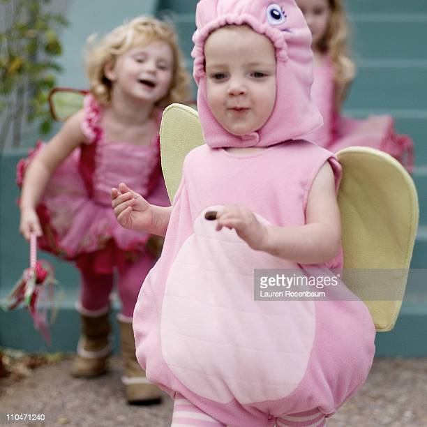 Three little girls in cute costumes