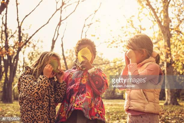 Three little girls in park.