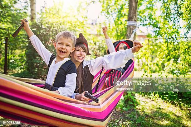 Three little pirates on hammock boat