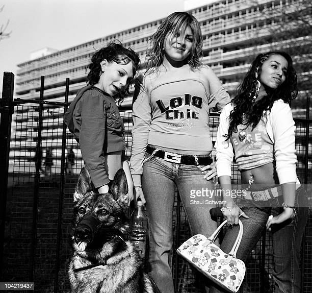Three local teenage girls stand with their dog in front of the Heygate Estate The rundown Heygate Estate has become a breeding ground for teenage...