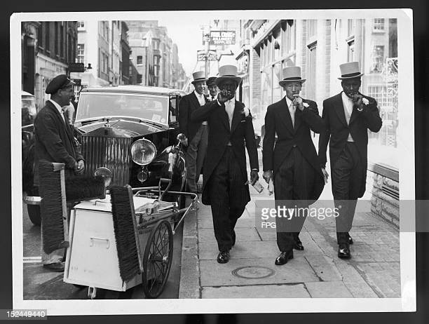 Three London streetsweepers take the day off to put on their best attire and visit Royal Ascot as the guests of a London shopkeeper 19th June 1962...