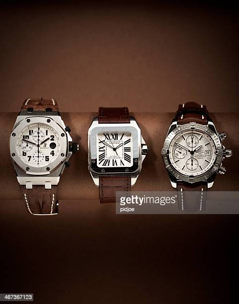Three luxury watches in a row