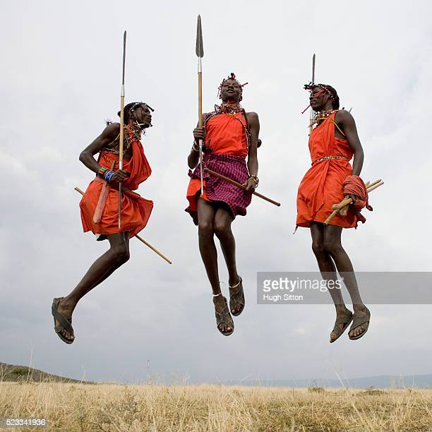three maasai warriors jumping - hugh sitton stock pictures, royalty-free photos & images