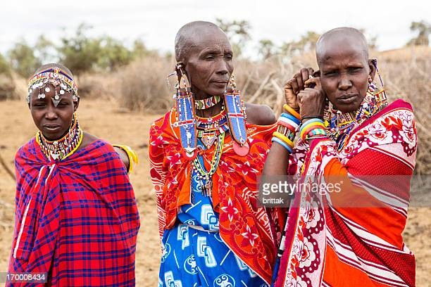 Three maasai woman in traditional dress with pearl jewellery