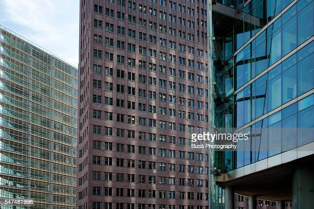 Three main towers of Potsdamer Platz, Berlin, Germany: from the left, the Daimler building, the Kollhoff tower, and the Bahn Tower