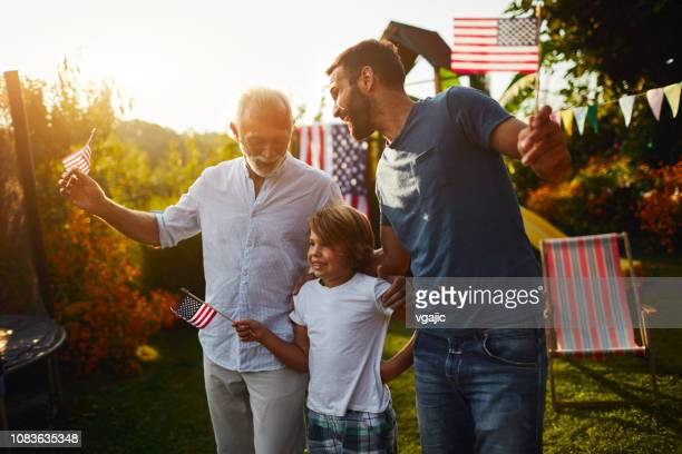 three male generations celebrating 4th of july - fourth of july stock pictures, royalty-free photos & images