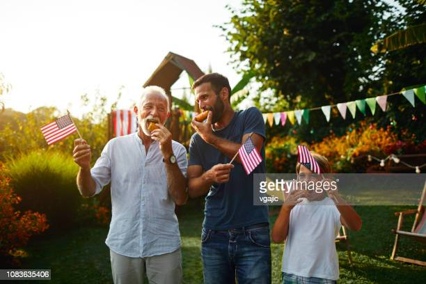 three male generations celebrating 4th of july - independence day stock pictures, royalty-free photos & images