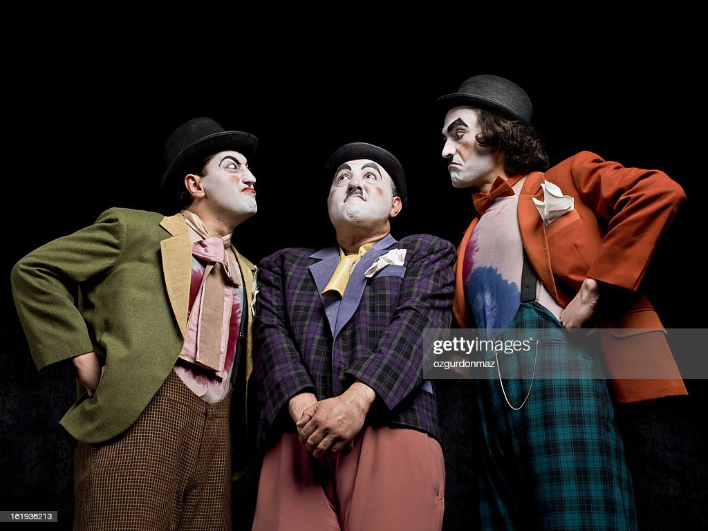 Três homens mimes no palco : Foto de stock