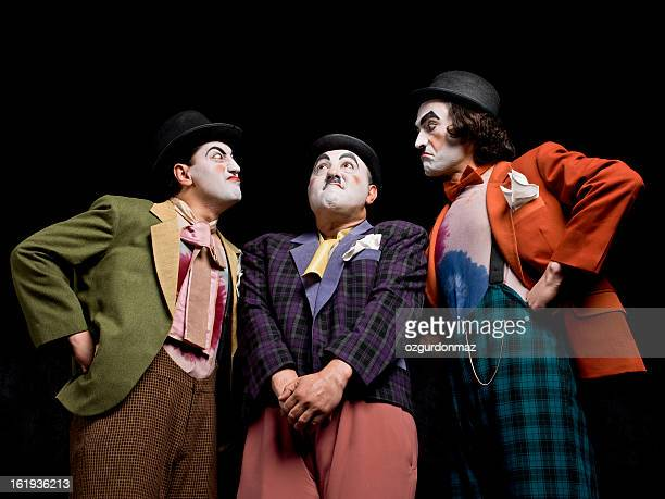 Three male mimes on the stage