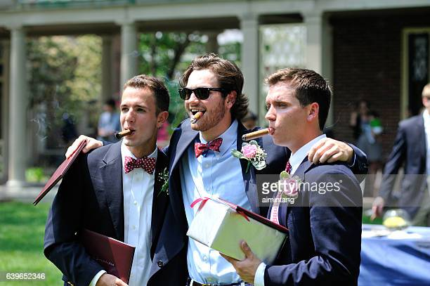 three male students smoking cigar - boarding school stock photos and pictures