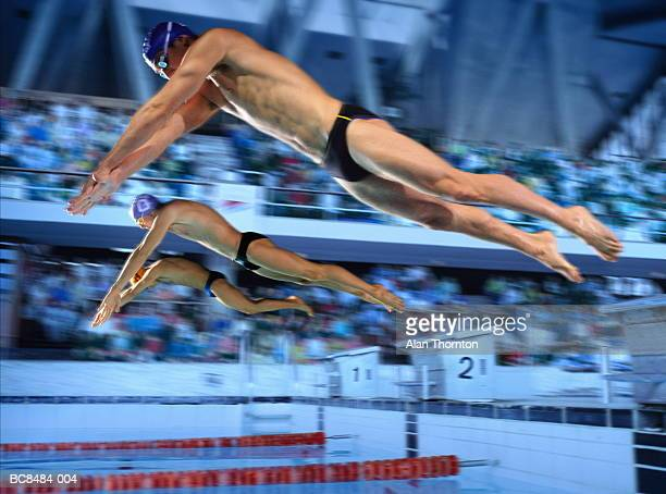 three male swimmers diving off starting blocks (digital composite) - young men in speedos stock pictures, royalty-free photos & images