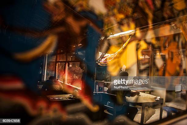Three man make shadow puppet known as ' wayang ' in Yogyakarta Indonesia on September 13 2016 Shadow puppet has been recognized as a world cultural...