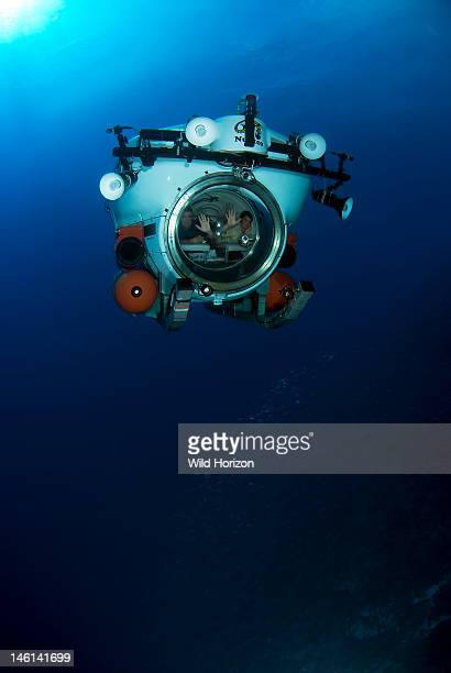 Three man minisub in midwater over coral reef Sea Aquarium Reef Curacao Netherlands Antilles Model and Property Released