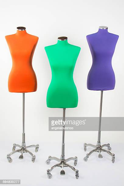 Three mannequins in a studio