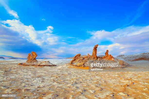Three Maria's rock formations Los Vigilantes - Atacama Desert Moon valley with White salt – Valle de La luna and Death Valley – dramatic moon surface landscape at gold colored sunset, Idyllic Atacama Desert, Volcanic landscape panorama –  Chile